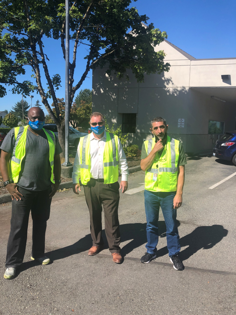 Enumclaw Mayor Jan Molinaro joins our club president Brian Bullard and member Jay Thomas in traffic control during the event.